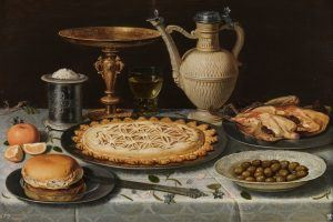 Clara Peeters. Mesa con mantel, salero, taza dorada, pastel, jarra, plato de porcelana con aceitunas y aves asadas. Óleo sobre tabla, Hacia 1611. ©Museo Nacional del Prado.